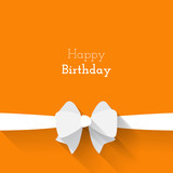 Simple card for birthday with a white paper bow on orange backgr