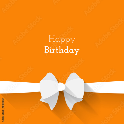 Simple card for birthday with a white paper bow on orange backgr - 81984167