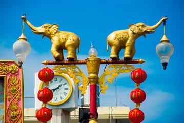 Elephants holding lanterns