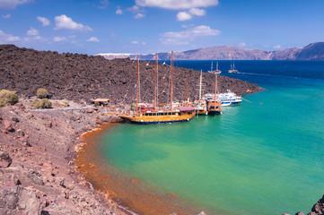 Sail boats docked at Nea Kameni