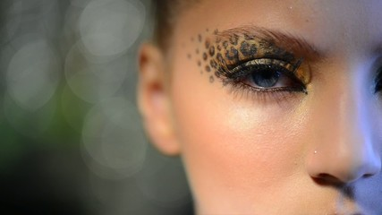 Beauty Girl with Holiday Leopard Makeup