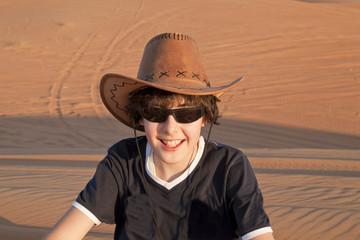 Happy teen in a desert
