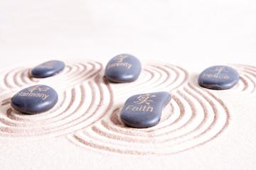 Zen art with swirling lines in golden sand