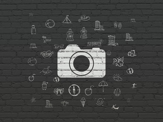 Tourism concept: Photo Camera on wall background