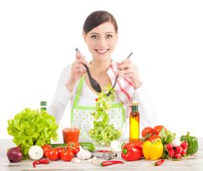 Happy housewife preparing salad.