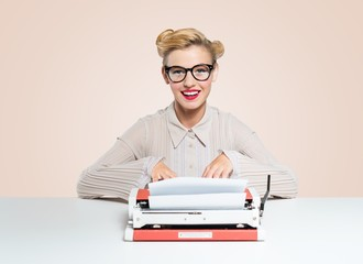 Woman. Beautiful woman writes with a typewriter