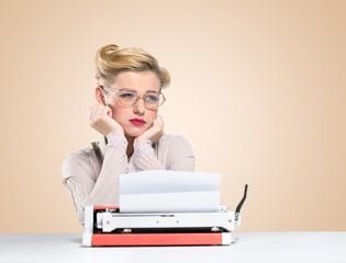 Journalist. Beautiful journalist looks typewriter