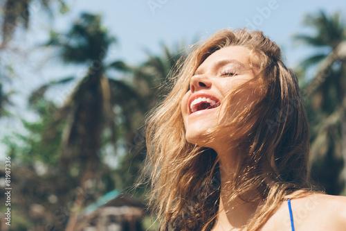 Pretty happy woman enjoying summer outdoors - 81987336