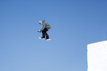 Snowboarder jumps in Snow Park