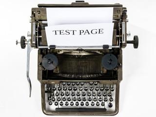Old vintage typewriter with blank paper sheet