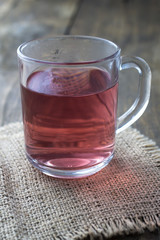 glass cup of tea on wood background