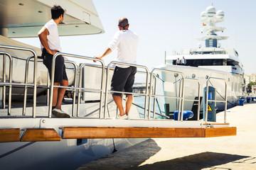 Yacht crew at port.