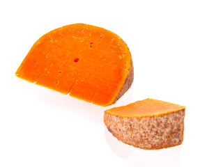 Old hand-made farm cheese slices