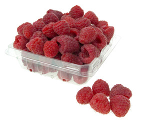 Raspberries outside container in group
