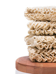 Ramen instant raw noodles stacked on wooden plank side border