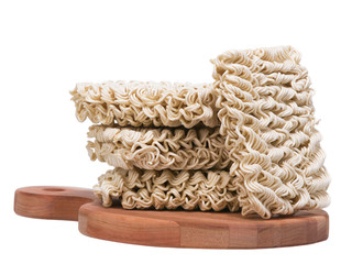 Ramen instant raw noodles on wooden plank 3/4
