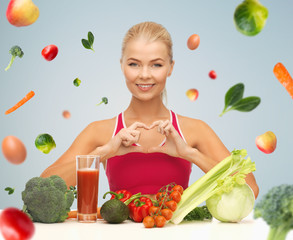 happy woman with vegetarian food showing heart