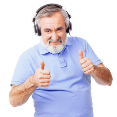 Old guy with headphones giving thumbs up