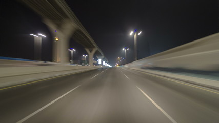Road and tunnel on the Palm Jumeirah island in Dubai at night