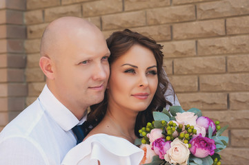 Sensual portrait of a beautiful bride and groom