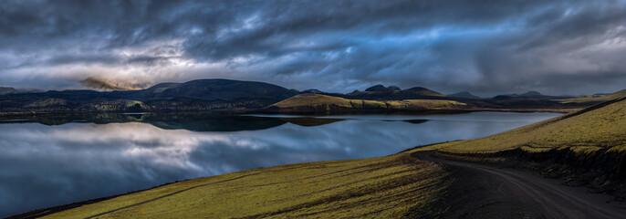 Sky and mountains reflected in lake, Landmannalaugar, Iceland.