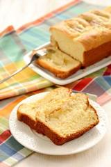 Mascarpone cake slice, long fork on white bright background