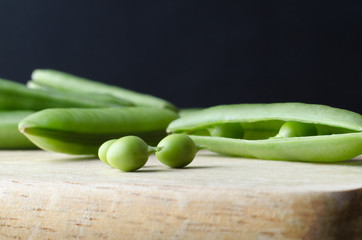 Peas and Pods on Kitchen Board