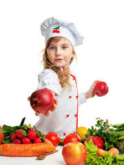 little cute girl in uniform chef holding apples