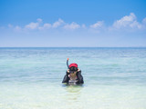 Woman wearing snorkel on summer vacation in tropical sea shore poster