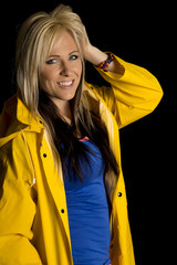 blond woman in yellow rain jacket smile on black