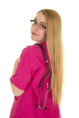 nurse in pink outfit with stethoscope look over shoulder
