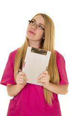 nurse pink clothes and glasses hold clipboard look up
