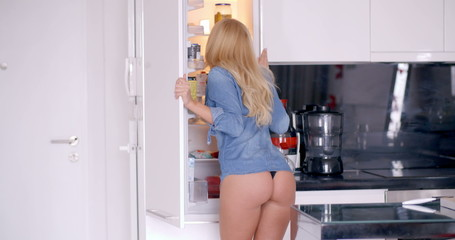 Shocked Sexy Woman at the Fridge