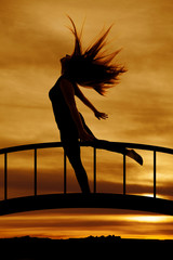 silhouette of woman hair flying leg back