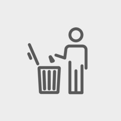 Man throwing garbage in a bin thin line icon