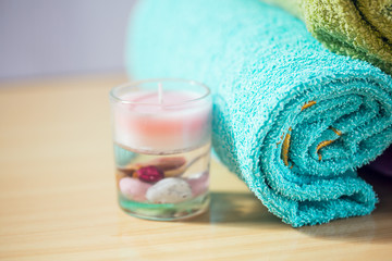 Composition with spa treatment, towels and candle