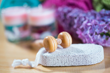 Composition with spa treatment, stone for heels