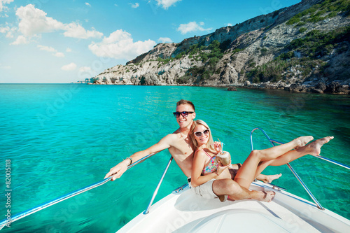 Foto op Aluminium Ontspanning Couple resting on a yacht at sea. Luxury holiday vacation.