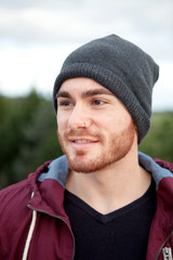 Handsome cool man with cap wool smiling