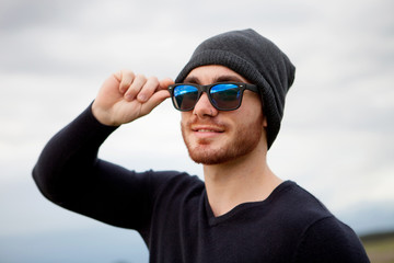 Handsome cool young man with sunglasses