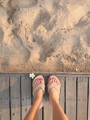 feet on the wood floor.