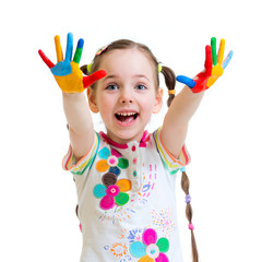 cheerful little girl with hands in paint on white