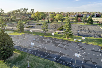 aerial view of basketball courts and park