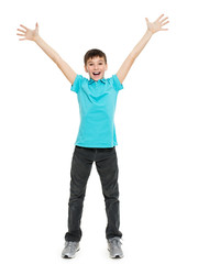Young happy teen boy with  with raised hands up.  in casuals