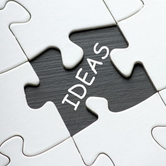 The word IDEAS revealed by a missing jigsaw piece