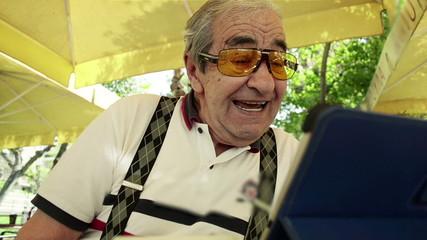 Pensioner studying digital tablet