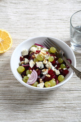Salad with beets and cheese, lemon