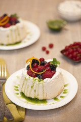 Pavlova with forest fruits and basil coulis