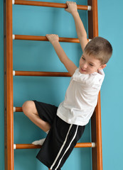boy looking down from the ladder