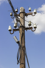 Wooden electrical pole with telephone lines
